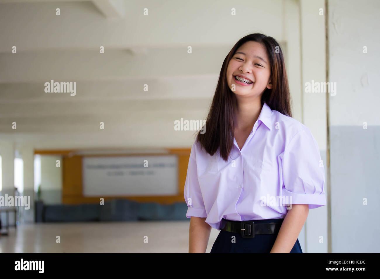 33108c568 Portrait of thai high school student uniform teen beautiful girl happy and  relax - Stock Image