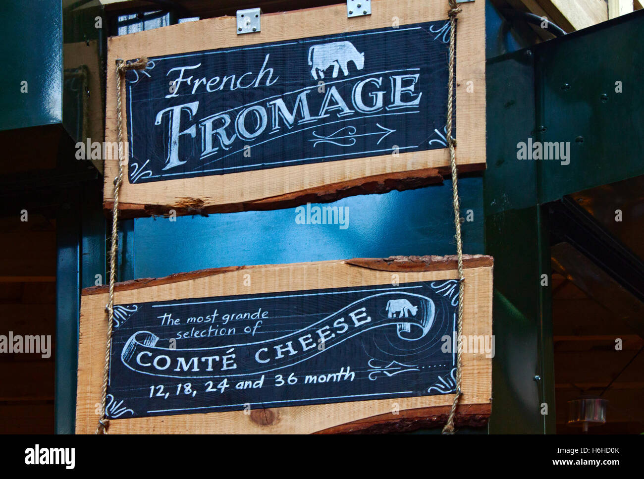 Blackboards advertising Fromage (French cheese) in Borough Market in Southwark near London Bridge - Stock Image