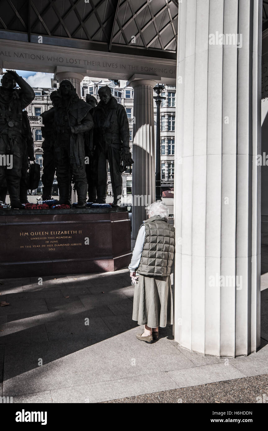 RAF Bomber Command Memorial is a memorial in Green Park, London, for crews of RAF Bomber Command. Elderly lady looks - Stock Image