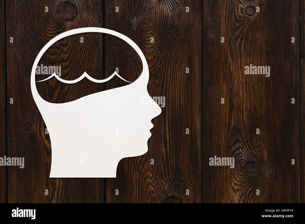 Paper head with sea waves inside, copy space. Abstract conceptual - Stock Image