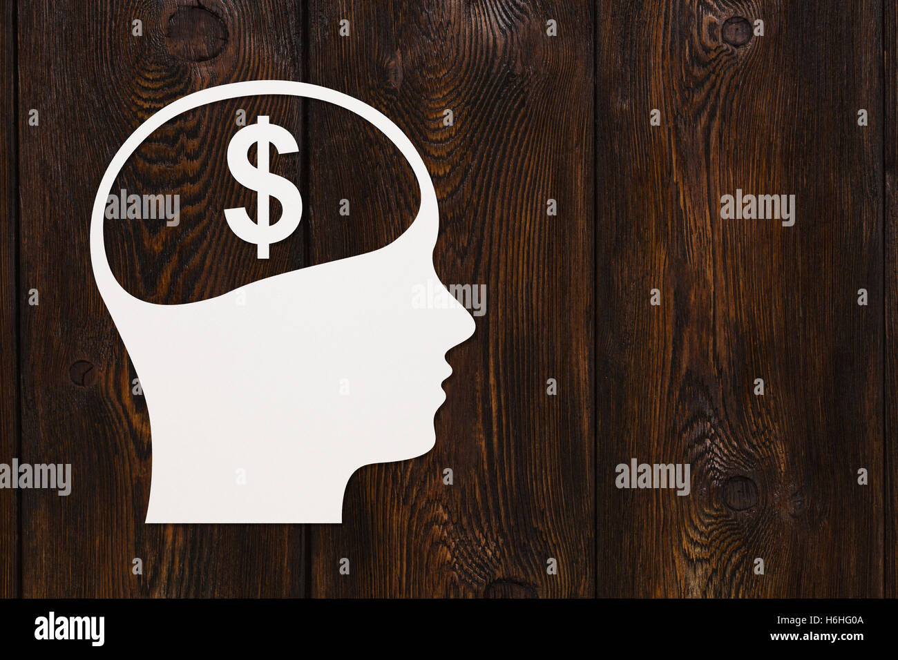 Paper head with dollar sign. Abstract conceptual image - Stock Image