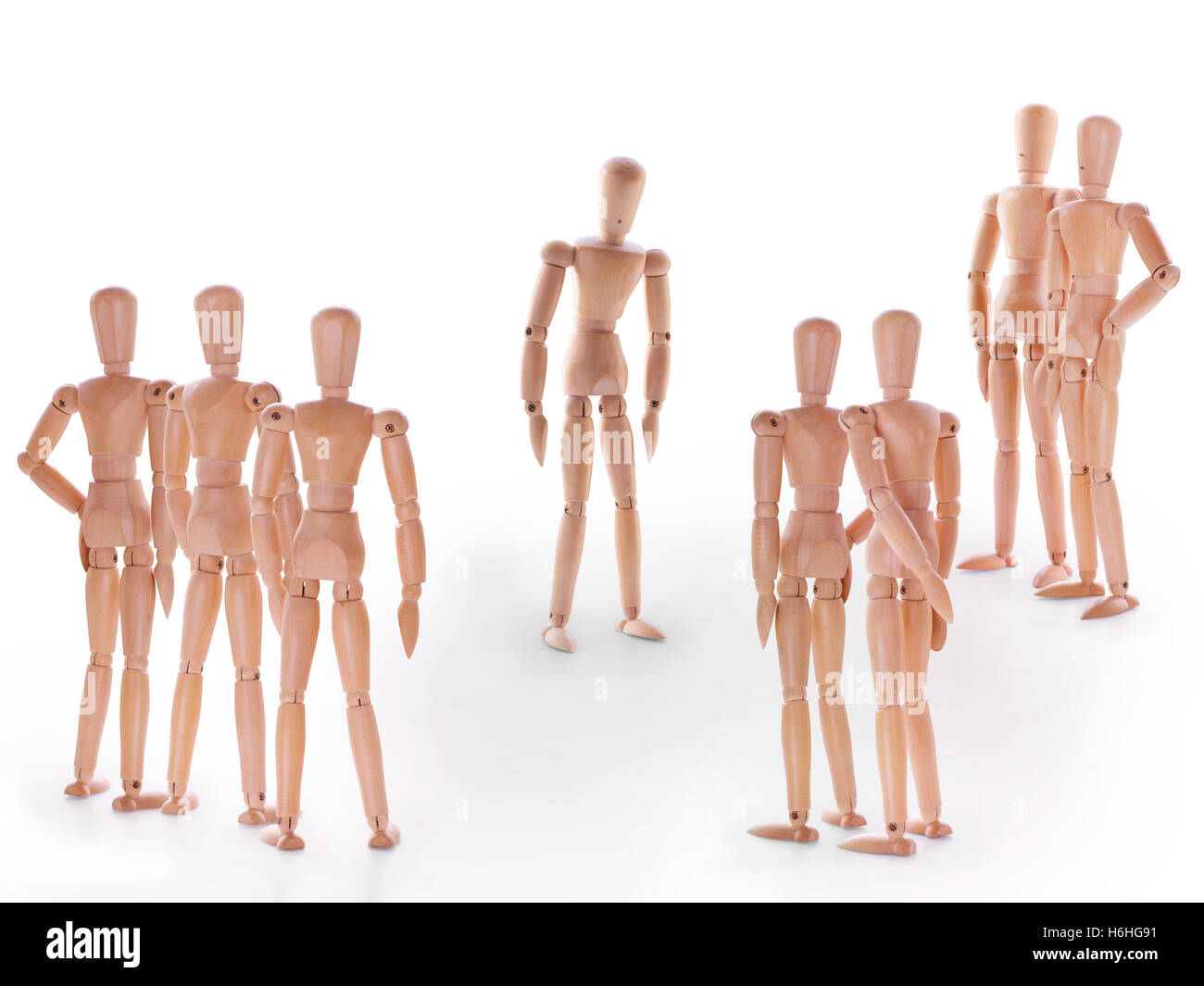 Scene with group of dummies, group of characters standing around one. Concept of accusation guilty person, bulling - Stock Image