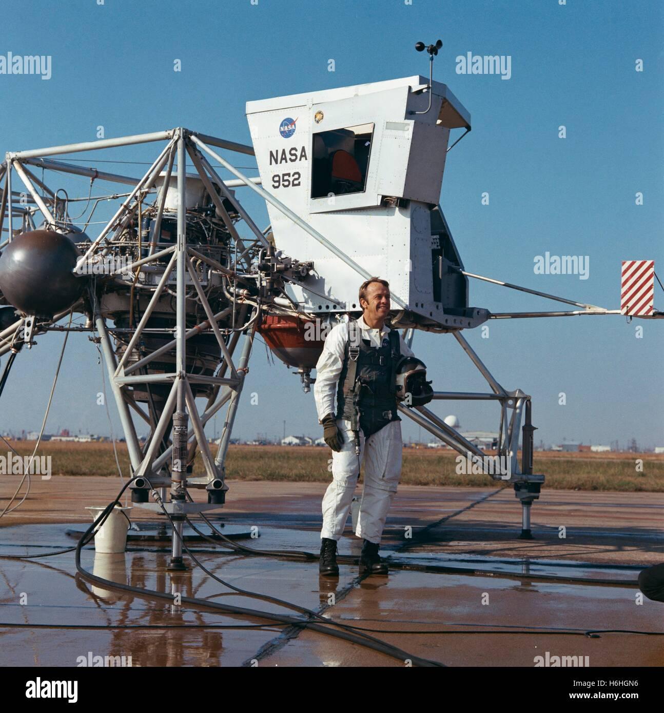 NASA Apollo 14 lunar landing mission astronaut American Alan Shepard stands next to a Lunar Landing Training Vehicle - Stock Image