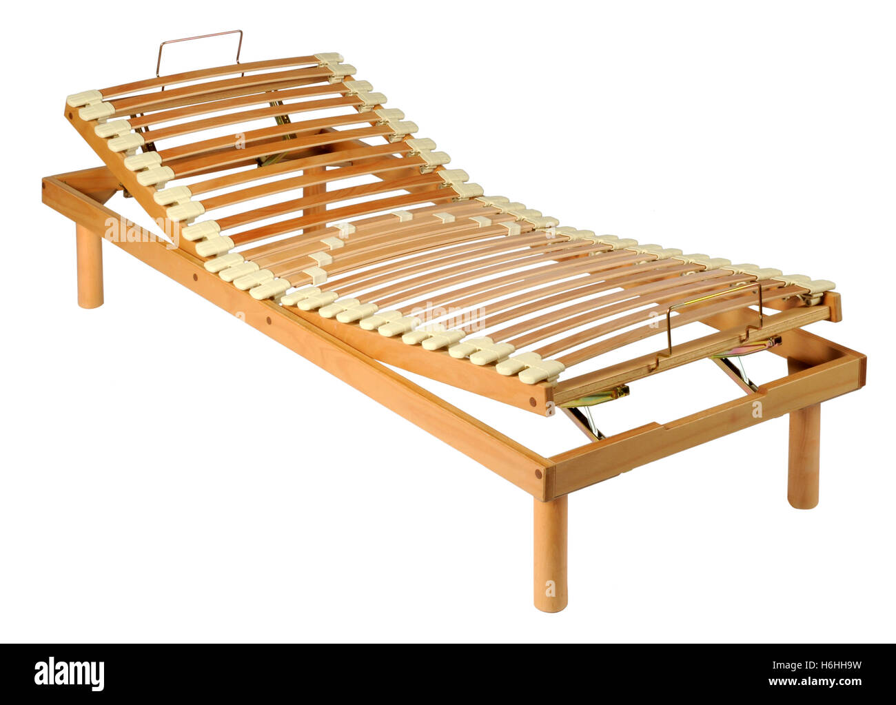 Wooden orthopedic net on an adjustable wood bed frame isolated on white in a three quarter view - Stock Image