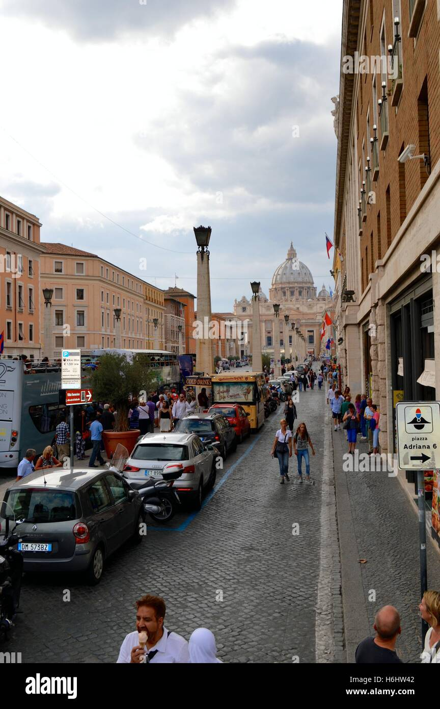 A busy street outside the Vatican Rome Italy - Stock Image