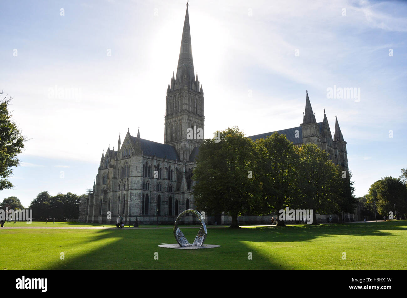 Salisbury Cathedral - view against the light - dramatic shape - sunlight and shadows - bright sunlight - Stock Image