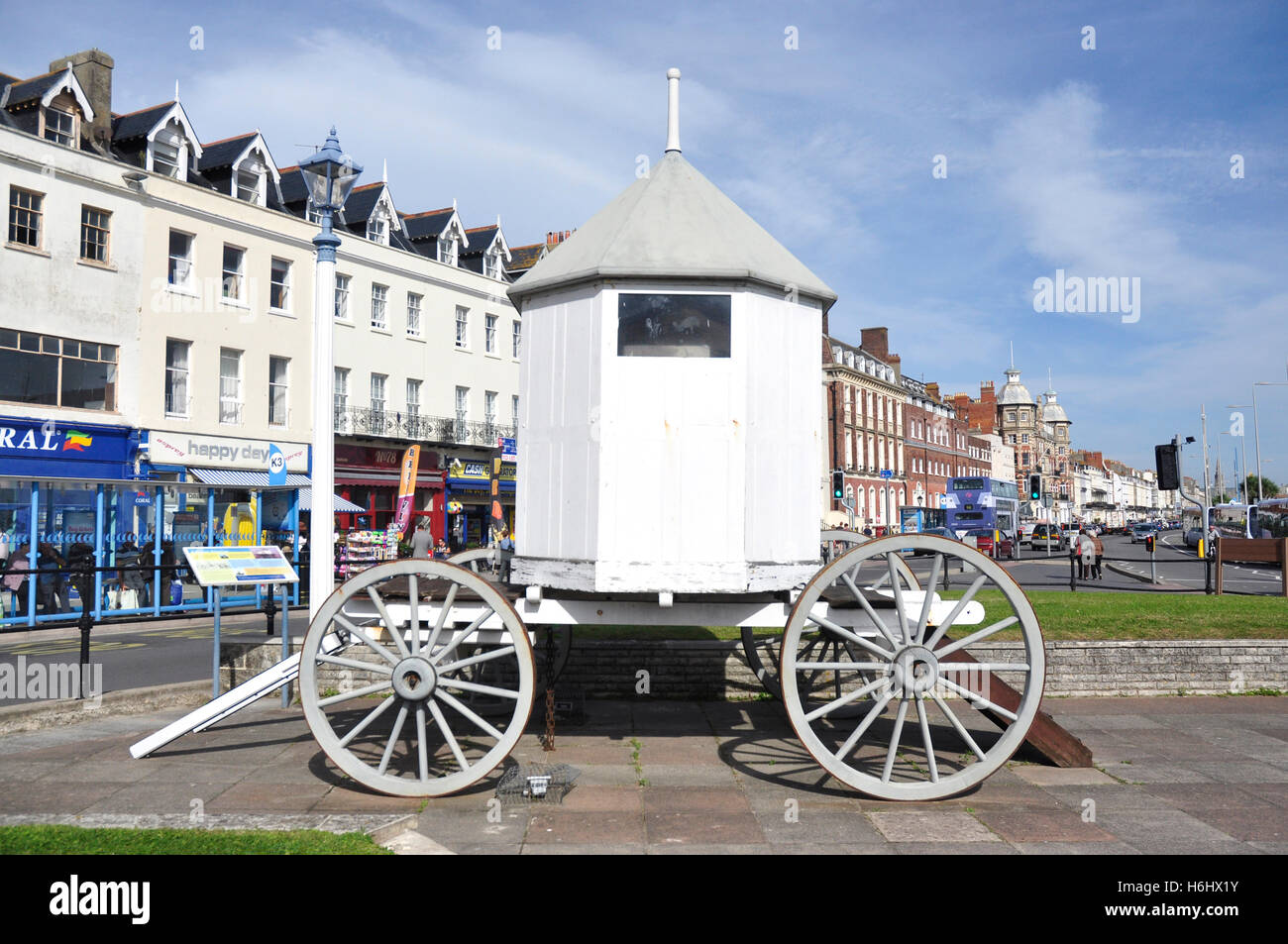 Full size replica sea bathing machine - as used by George 111 - Weymouth seafront - sunlight - blue sky - Stock Image