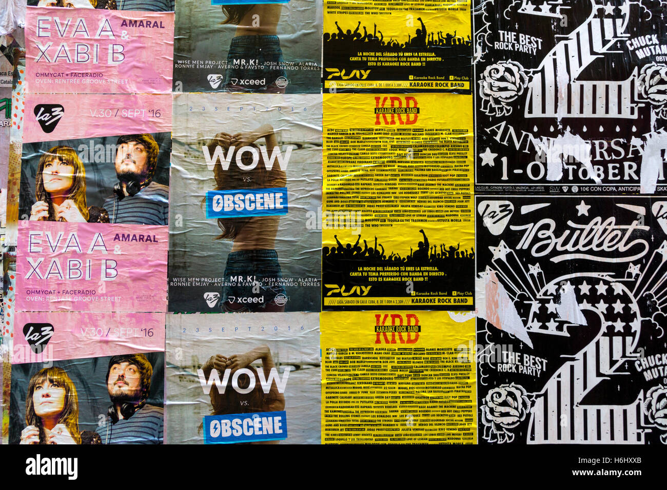Fly posters advertising local events in English and Spanish on a ...