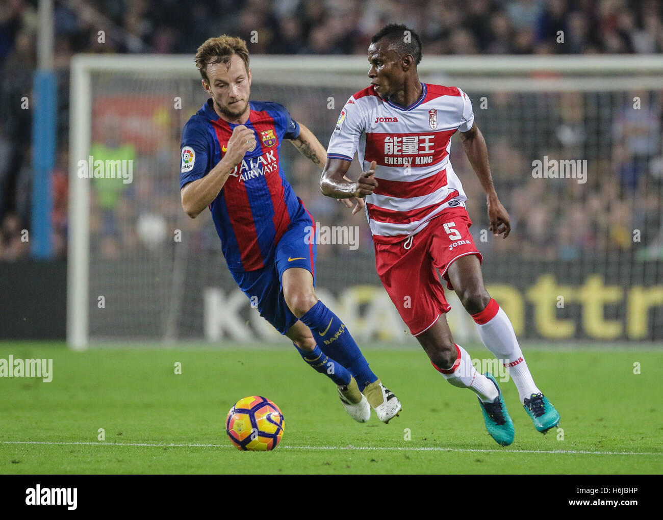 Uche has the ball against Rakitic. FC Barcelona defeated Granada 1-0 with goal scored by Rafinha at the 47th minute. - Stock Image