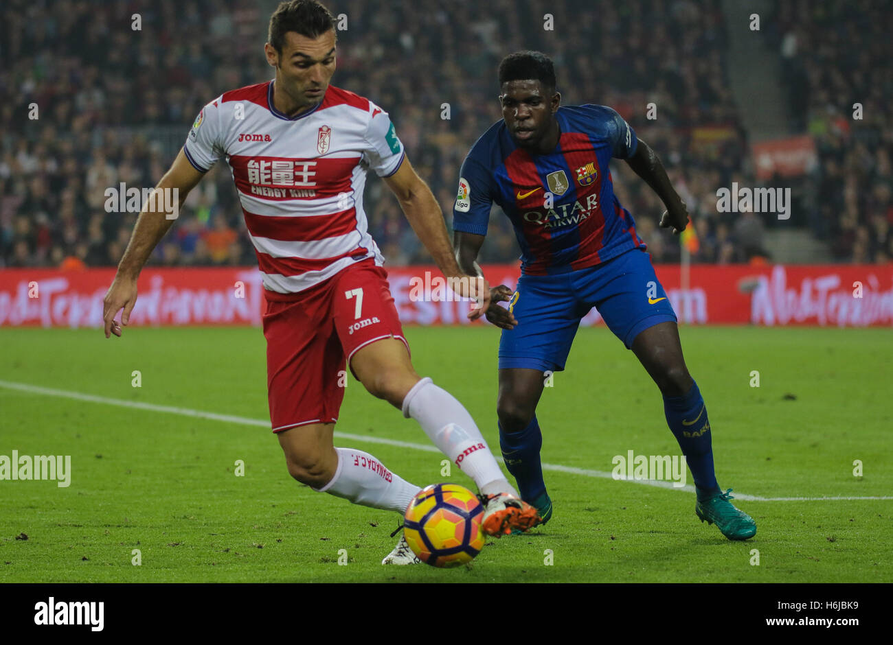 Barral and Umtiti during the match. FC Barcelona defeated Granada 1-0 with goal scored by Rafinha at the 47th minute. - Stock Image