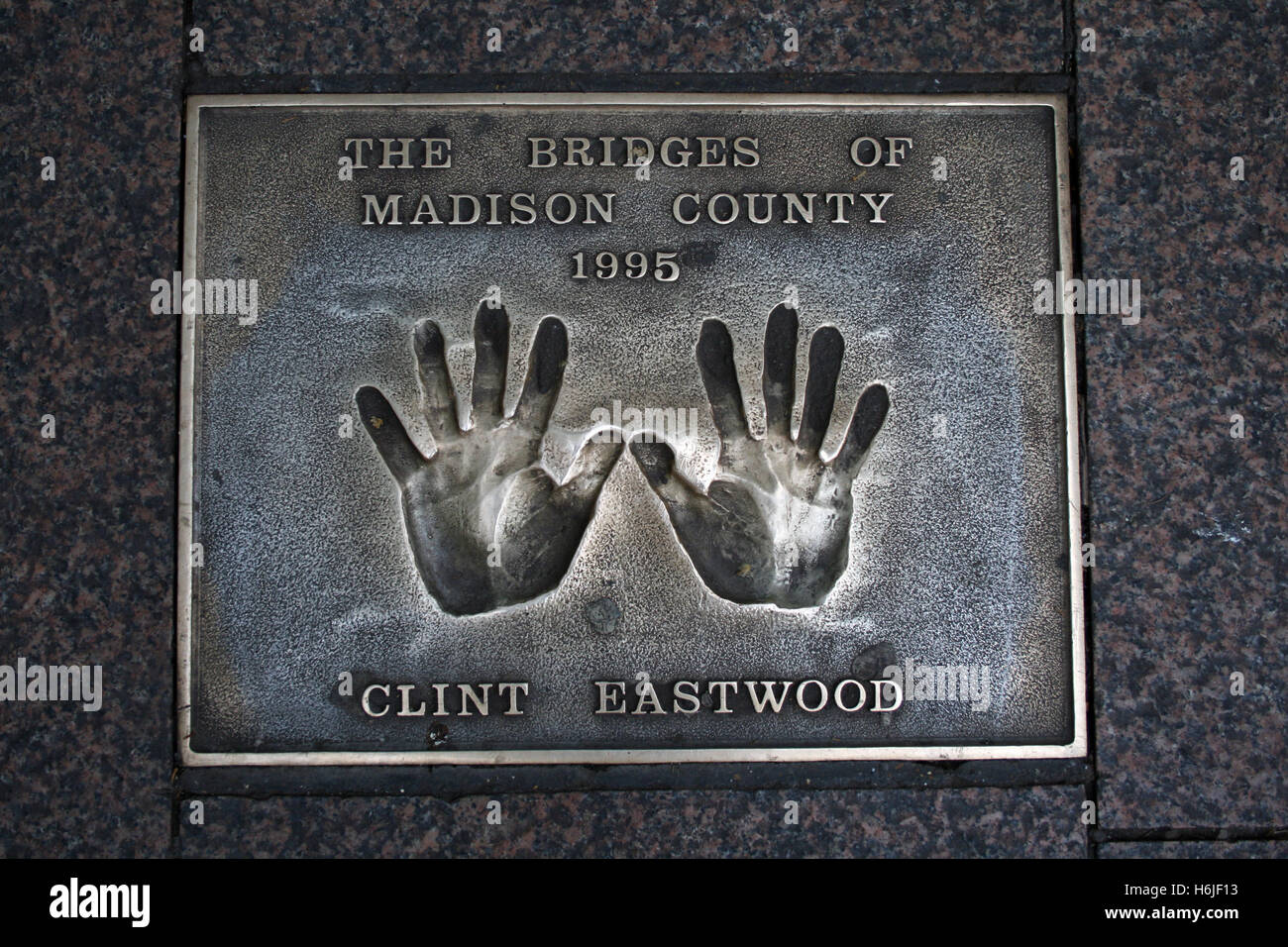 Plaque with Clint Eastwood's cast handprints, Leicester Square, London, UK. - Stock Image