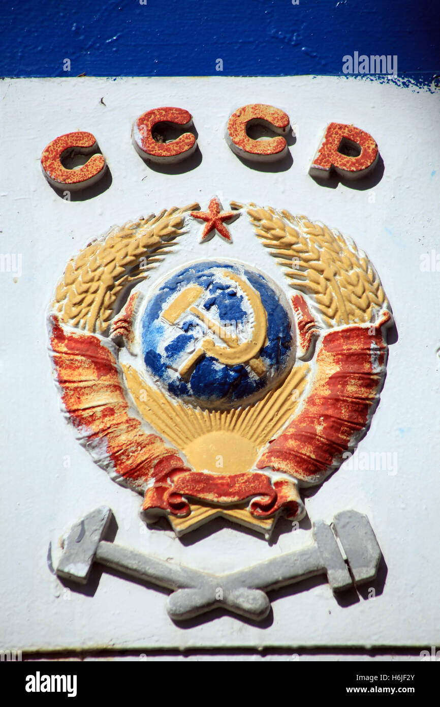 Soviet railway emblem placed on a disused locomotive. - Stock Image