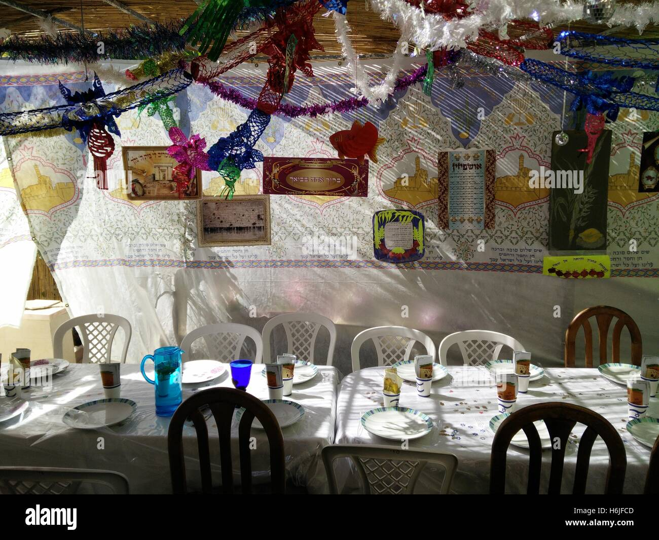 Interior of a decorated Sukkah erected for the Jewish Holiday od Sukkoth - Stock Image
