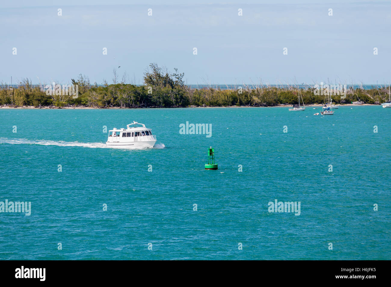Ferry by Green Channel Marker in Harbor - Stock Image