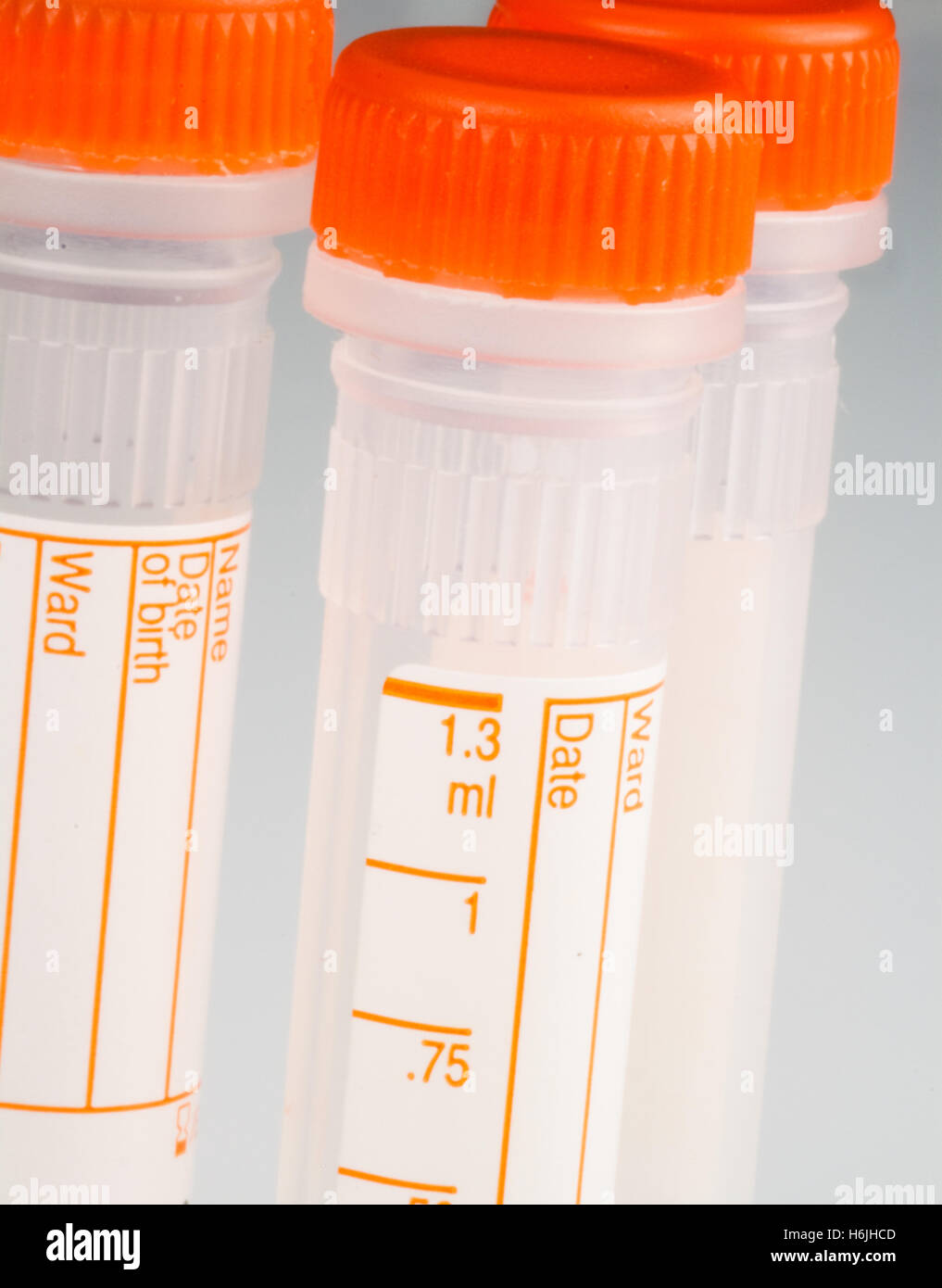 close up of empty heparin blood sample tubes - Stock Image