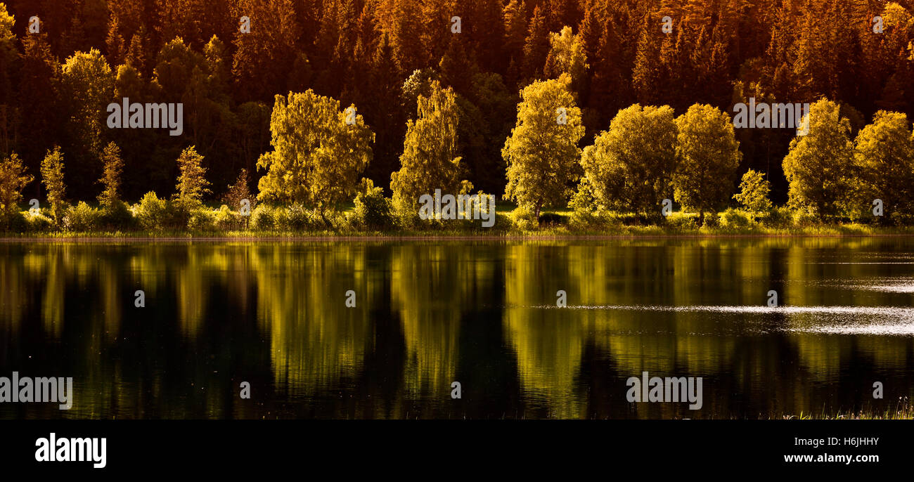 inland lake mirrored in a peaceful landscape - Stock Image