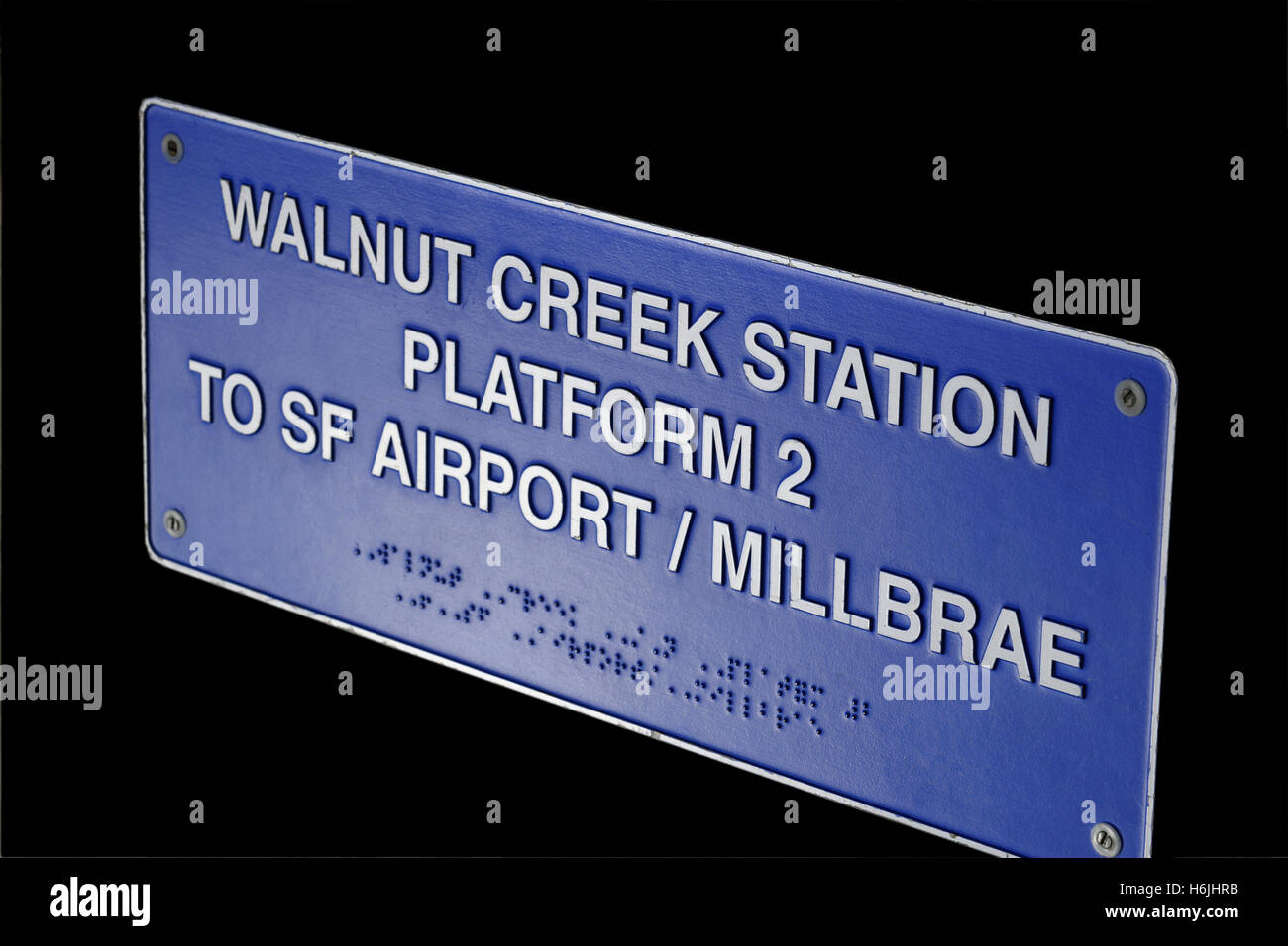 Metal plaque sign on Walnut Creek 'Bart' station with platform information duplicated in Braille for visually - Stock Image