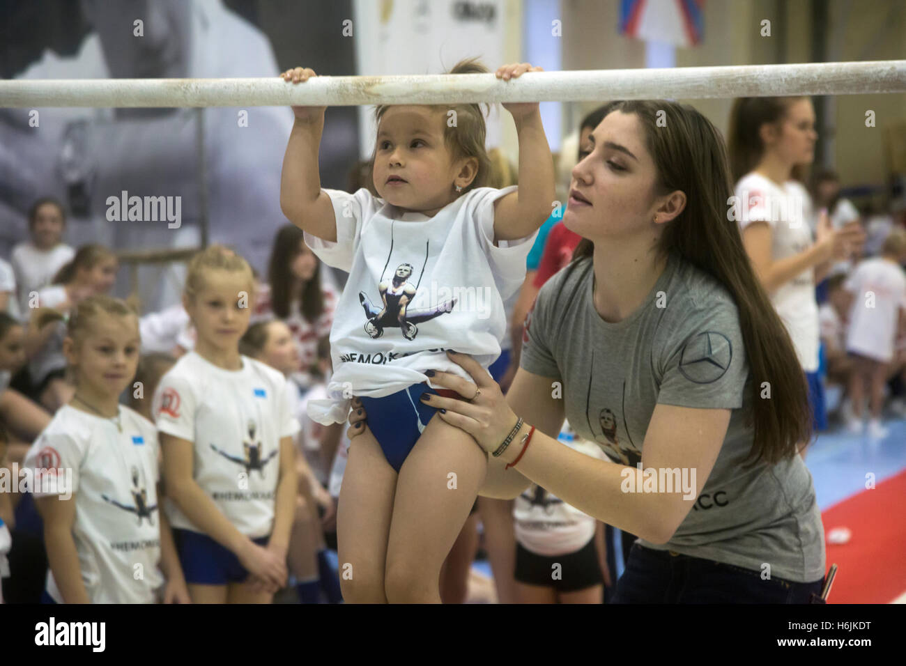 Russia's Olympic champion in artistic gymnastics Aliya Mustafina during the master class in gymnastics for children - Stock Image