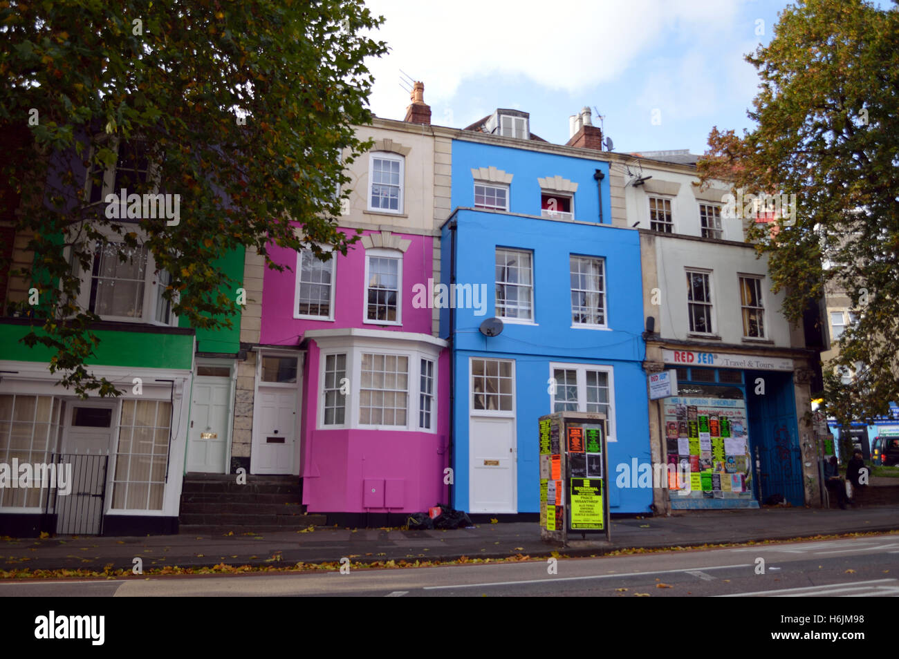 Coloured terraced houses in Gloucester Road in Stokes Croft, Bristol. - Stock Image