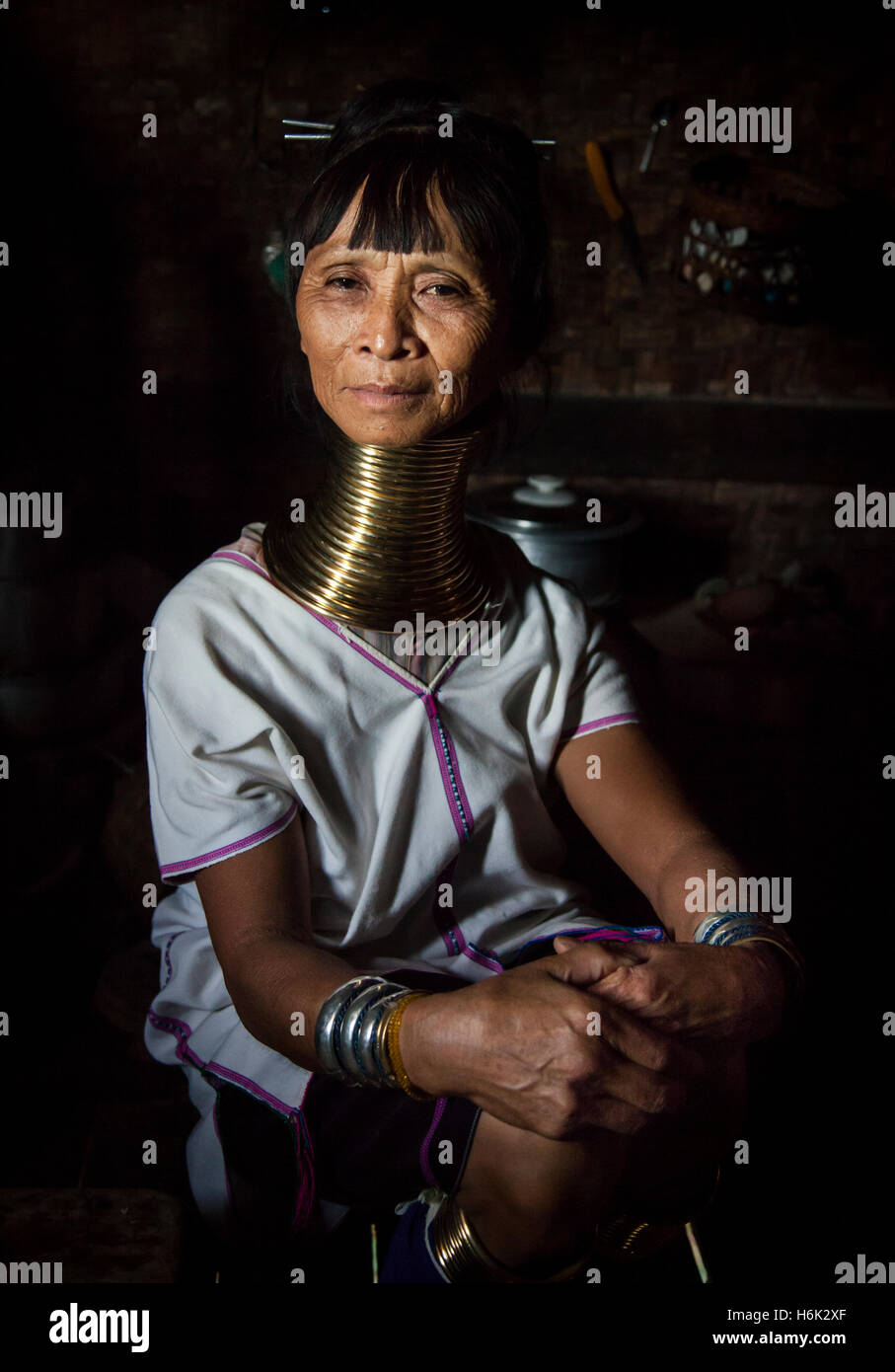 Lake Inle, Myanmar, 17th November, 2014: Kayan tribe woman in her kitchen posing Stock Photo