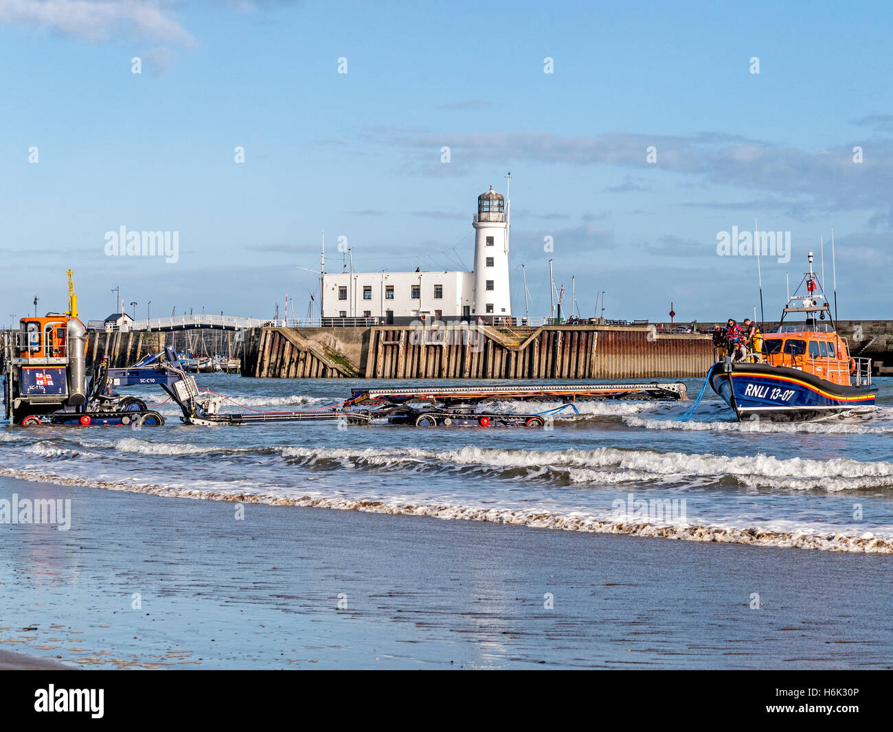 Recovering Shannon Class Lifeboat 13-07 with the Supercat Tractor and Carriage  at Scarborough Yorkshire UK - Stock Image