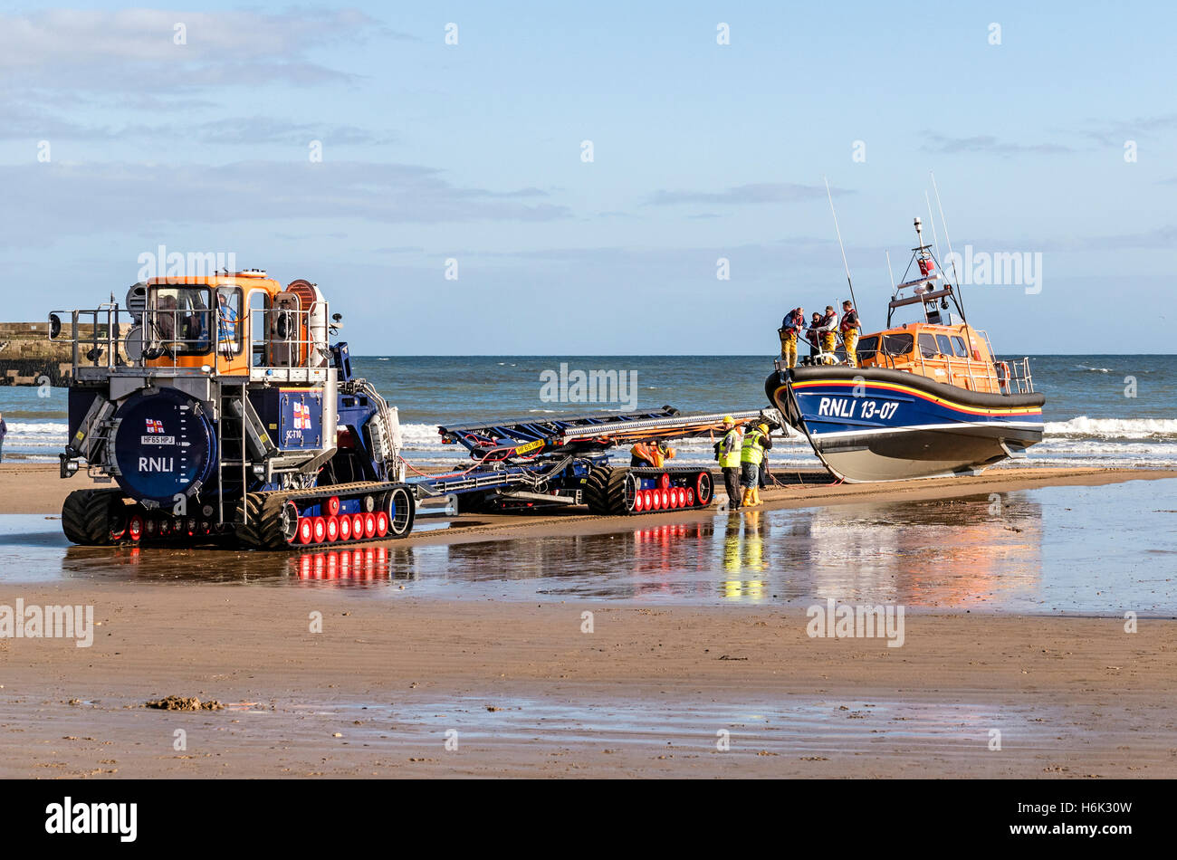 Recovering RNLI Shannon Class Lifeboat 13-07 with the Supercat Tractor and Carriage  at Scarborough Yorkshire UK - Stock Image
