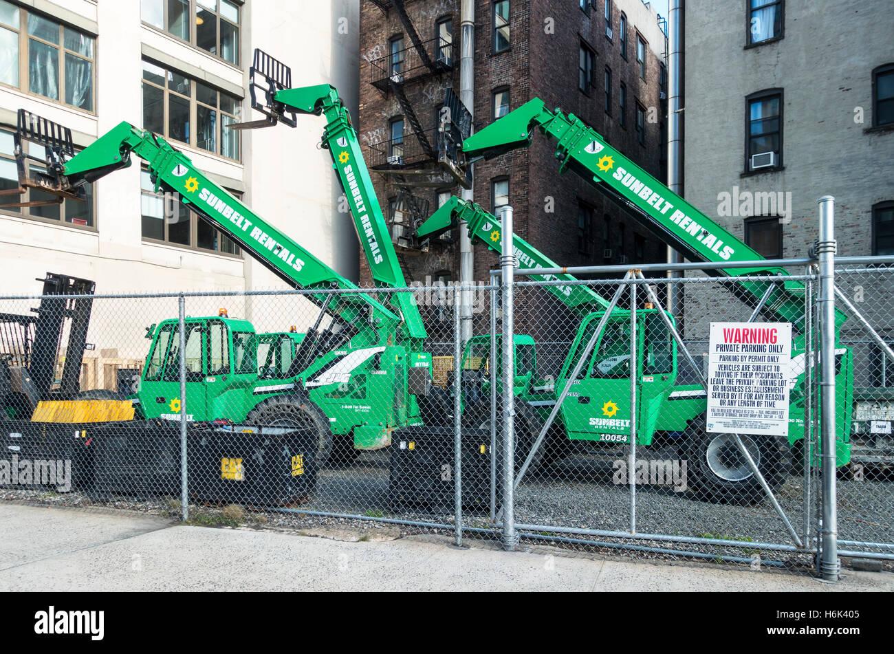 Three trucks with lifts, telescopic cranes in New York City - Stock Image
