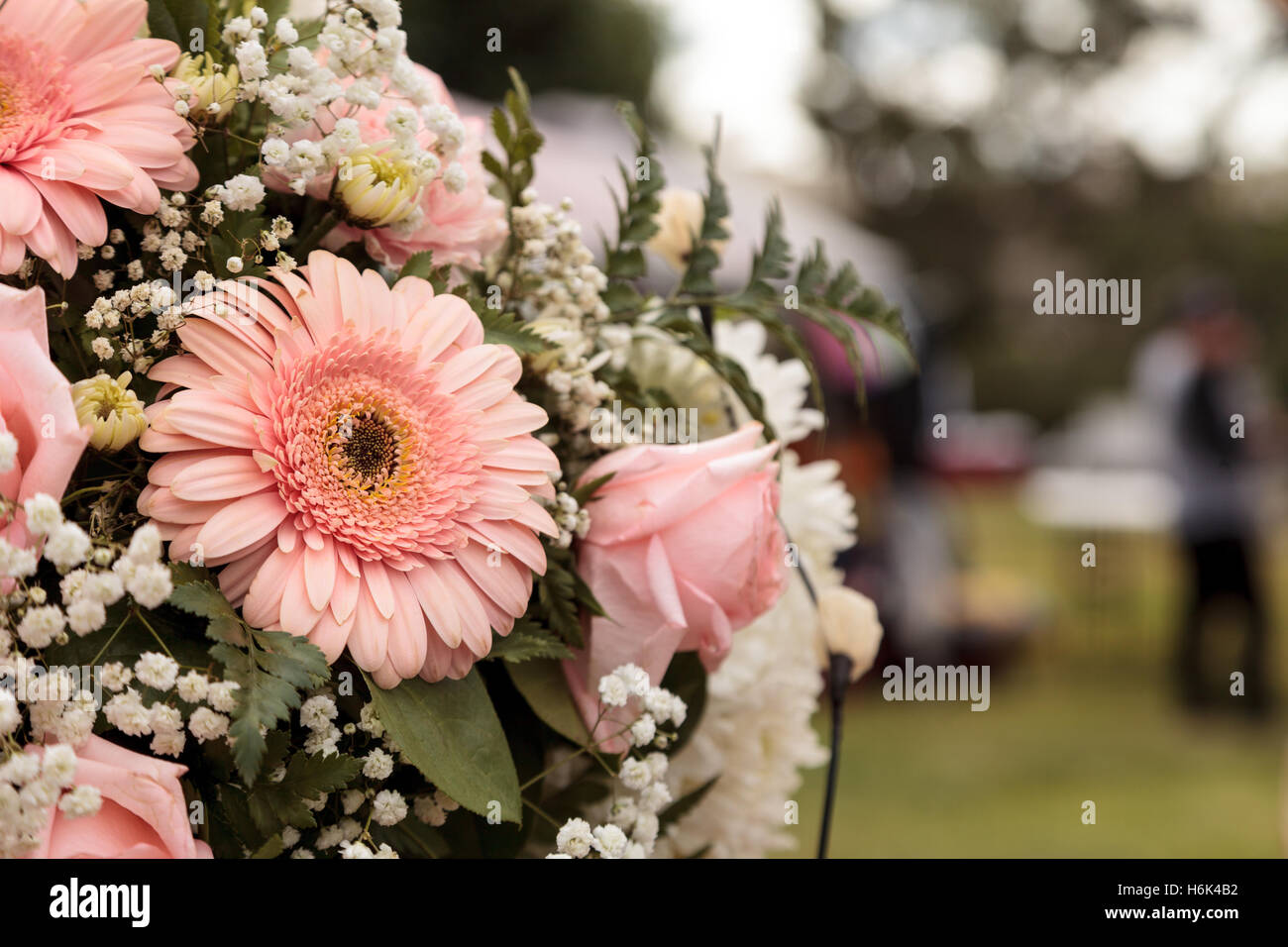 Bouquet of pink roses and pink gerbera daisies in a wedding flower bouquet of pink roses and pink gerbera daisies in a wedding flower arrangement izmirmasajfo