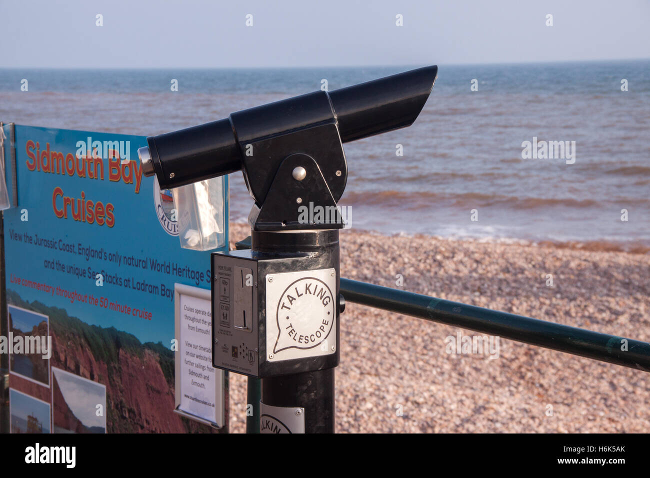 A talking telescope on the seafront at Sidmouth, Devon. It provides an audible interpretation of the view. - Stock Image