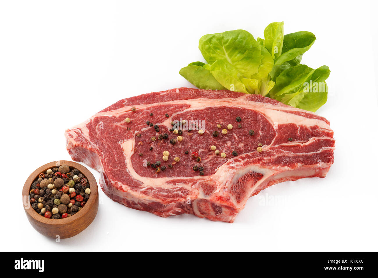juicy organic raw steak on a isolated white background - Stock Image