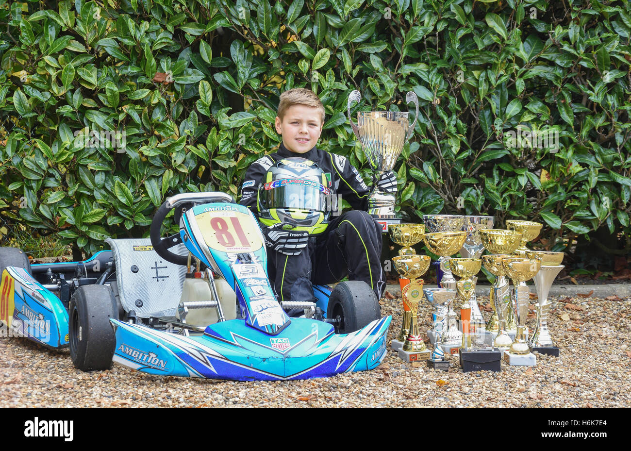 Young boy kart racer with racing trophies, Staines-upon-Thames, Surrey, England, United KingdomStaines-upon-Thames, - Stock Image
