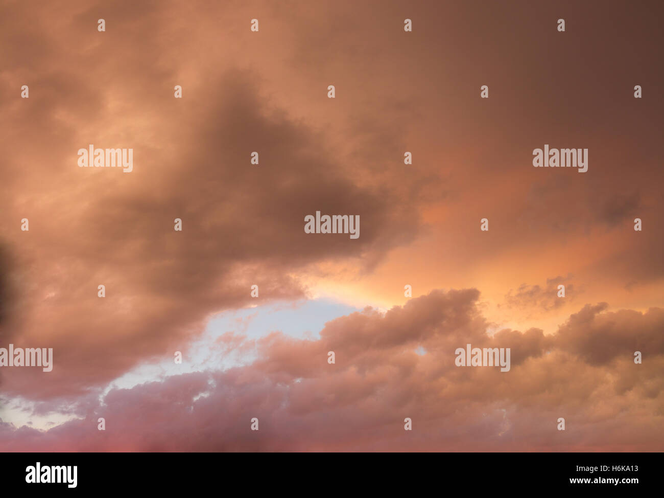 Colourful skyscape with versicolored clouds at sunset dusk - Stock Image