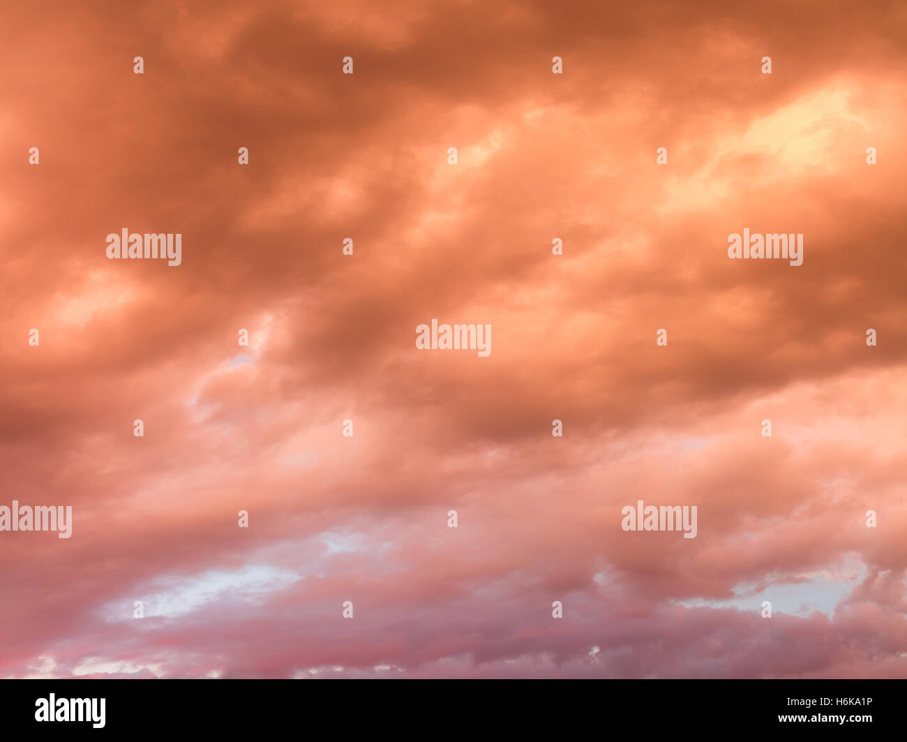 Colorful skyscape with versicolored clouds at sunset dusk - Stock Image