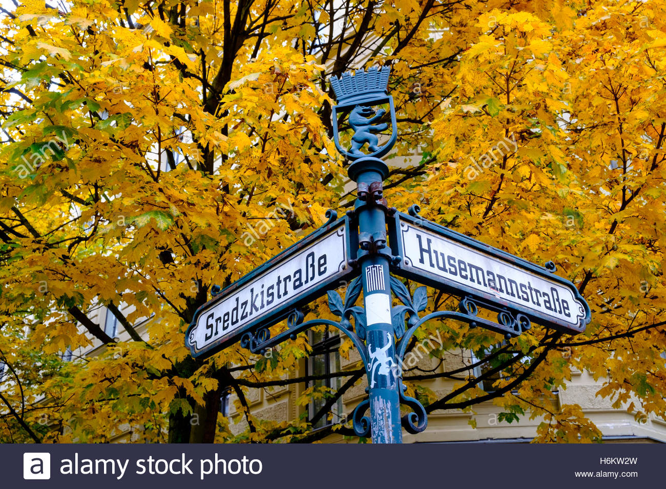 Ornate old street sign at Husemannstrasse in bohemian Prenzlauer Berg during Autumn in Berlin Germany - Stock Image