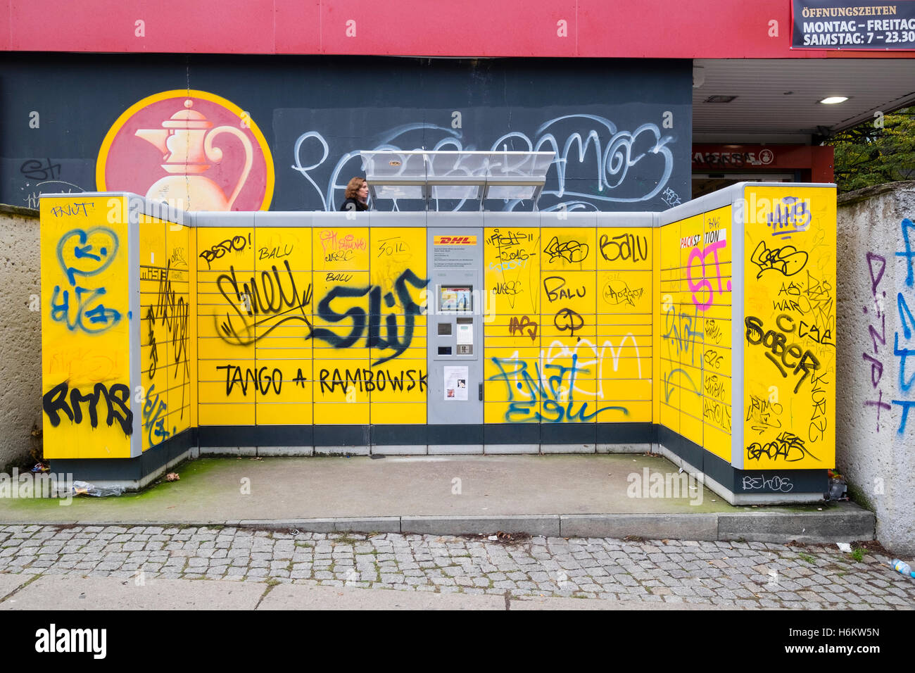 dhl self service parcel drop off lockers covered in graffiti in stock photo 124597361 alamy. Black Bedroom Furniture Sets. Home Design Ideas