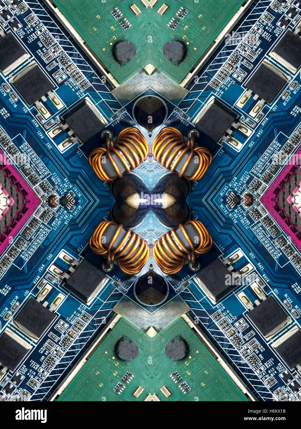 A kaleidoscope image made from the inside of a computer - its motherboard, computer chip, and electronic parts. - Stock Image