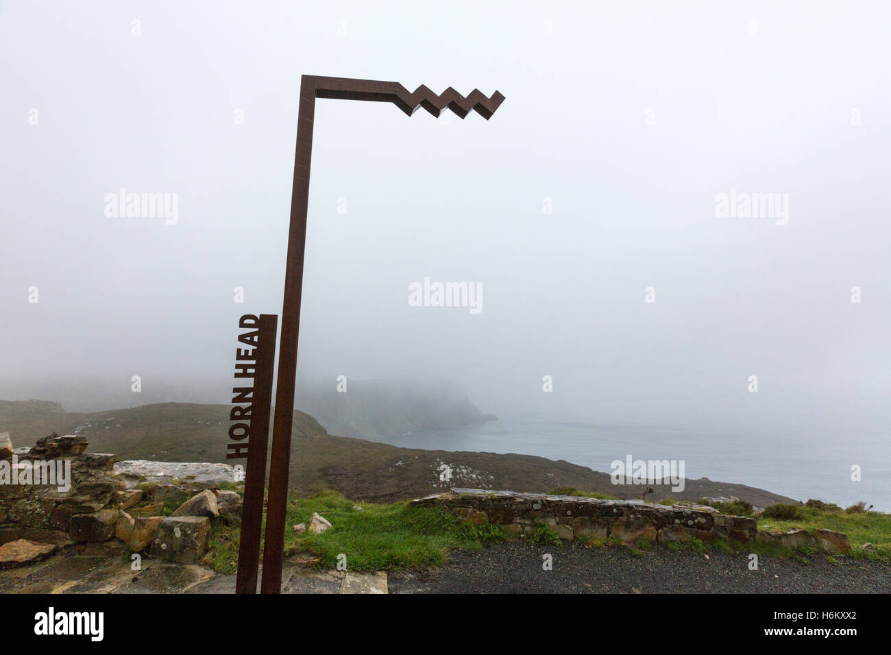 Wild Atlantic Way  sign in a misty Horn Head, Donegal County, Ireland - Stock Image