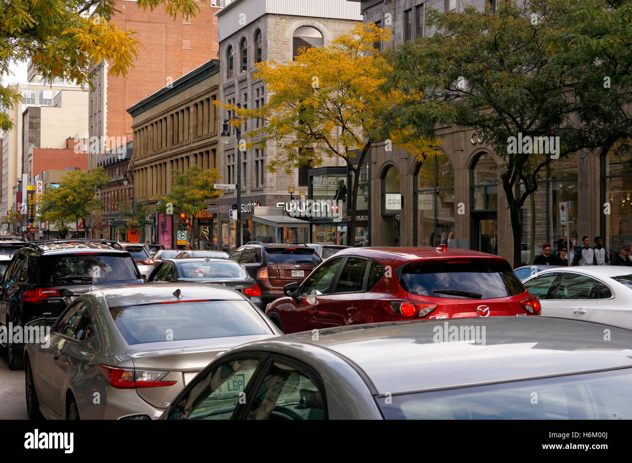 Traffic congestion on Rue Sainte-Catherine or Saint Catherine Street in downtown Montreal, Quebec, Canada - Stock Image