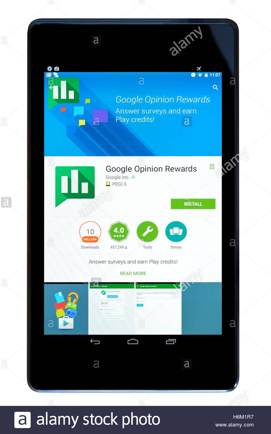 Online survey app Google Opinion Rewards shown on a tablet computer, Dorset, England, UK - Stock Image