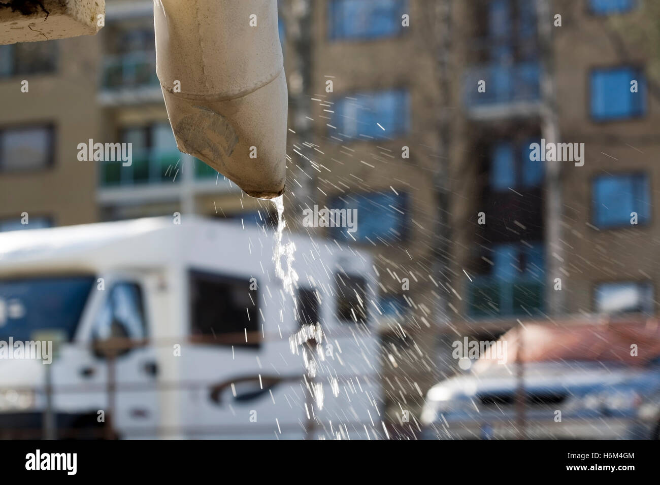 water dripping down the drainpipe - Stock Image