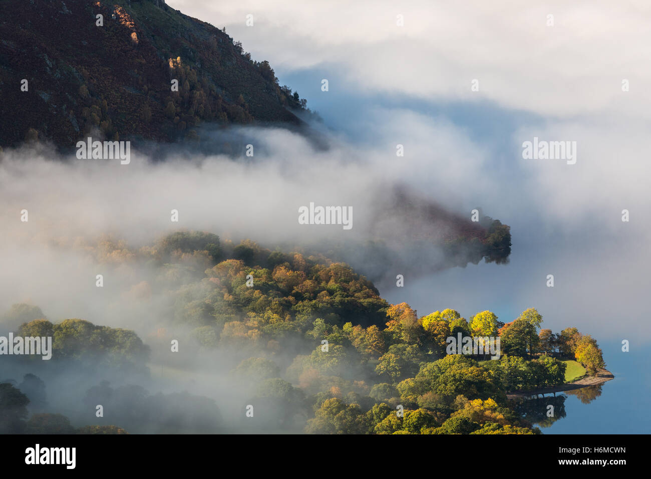Autumnal misty dawn looking across Ullswater in the Lake District, England Stock Photo