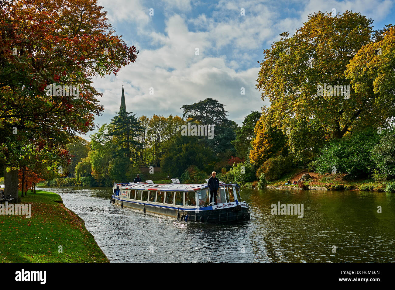 Pleasure cruiser on the River Avon in Stratford upon Avon, with autumnal colours on the trees. - Stock Image