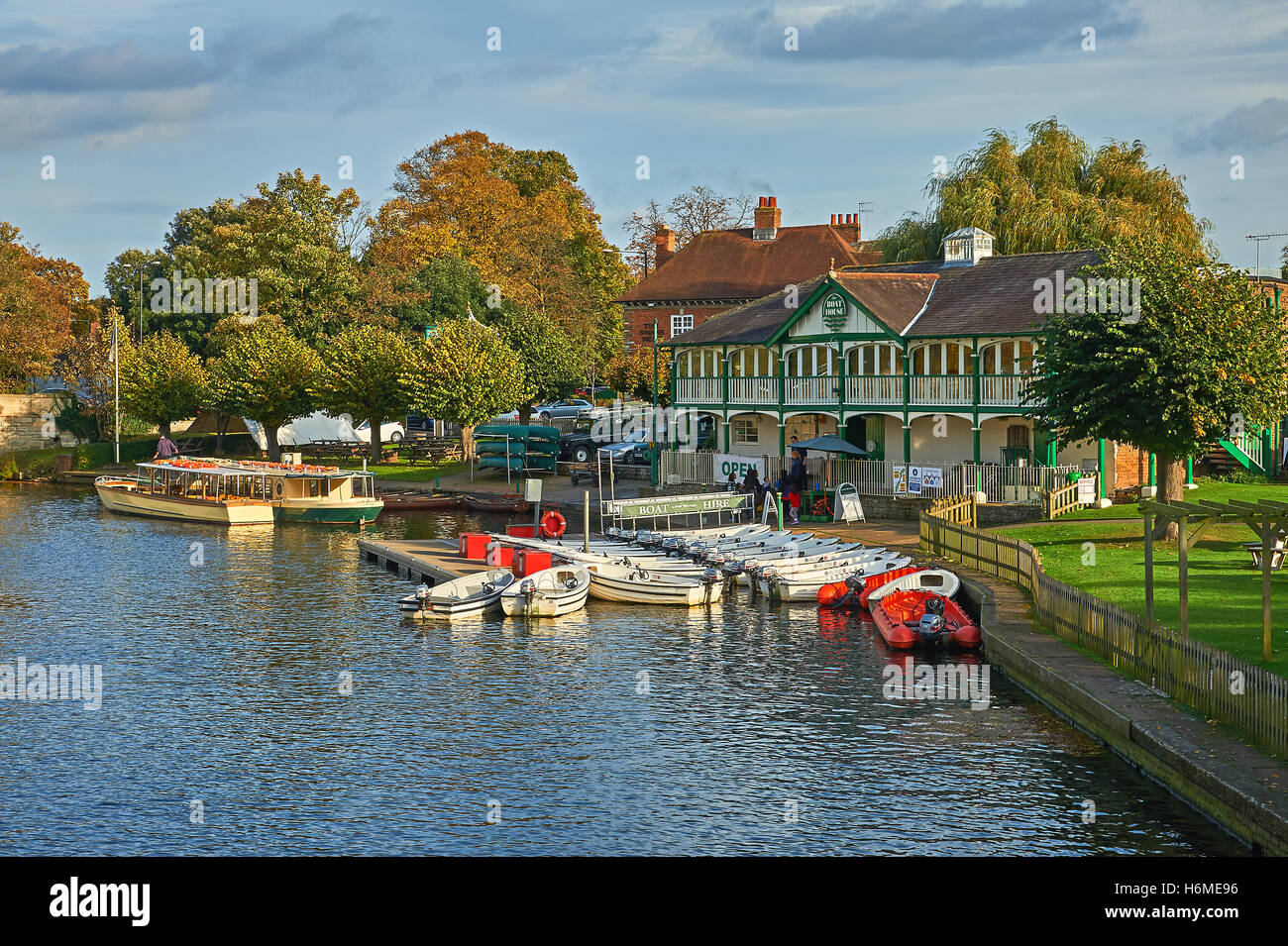 Boats moored outside the old boathouse on the River Avon in the heart of Stratford upon Avon - Stock Image