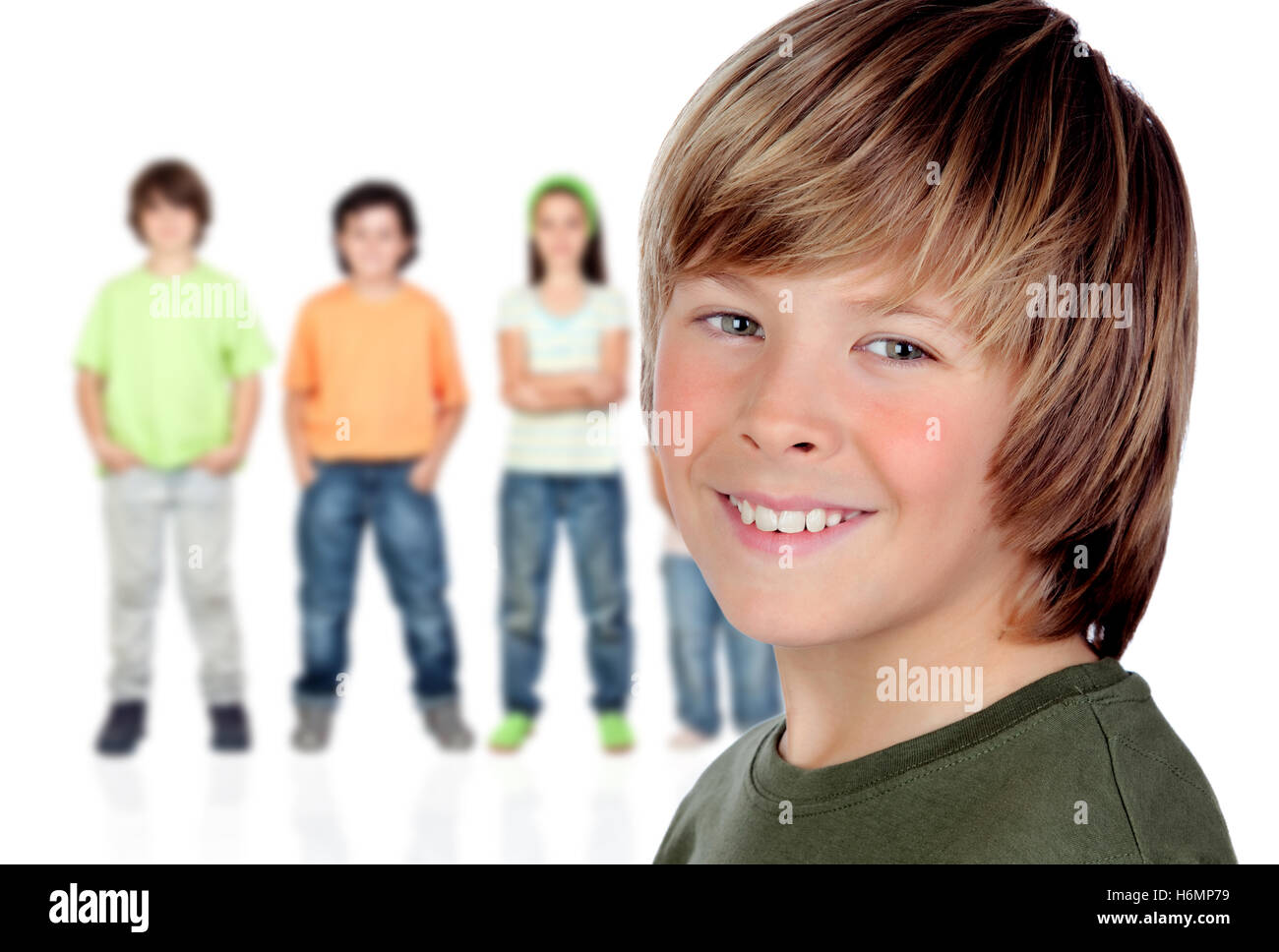 Casual preteen boy and unfocused casual children of background - Stock Image