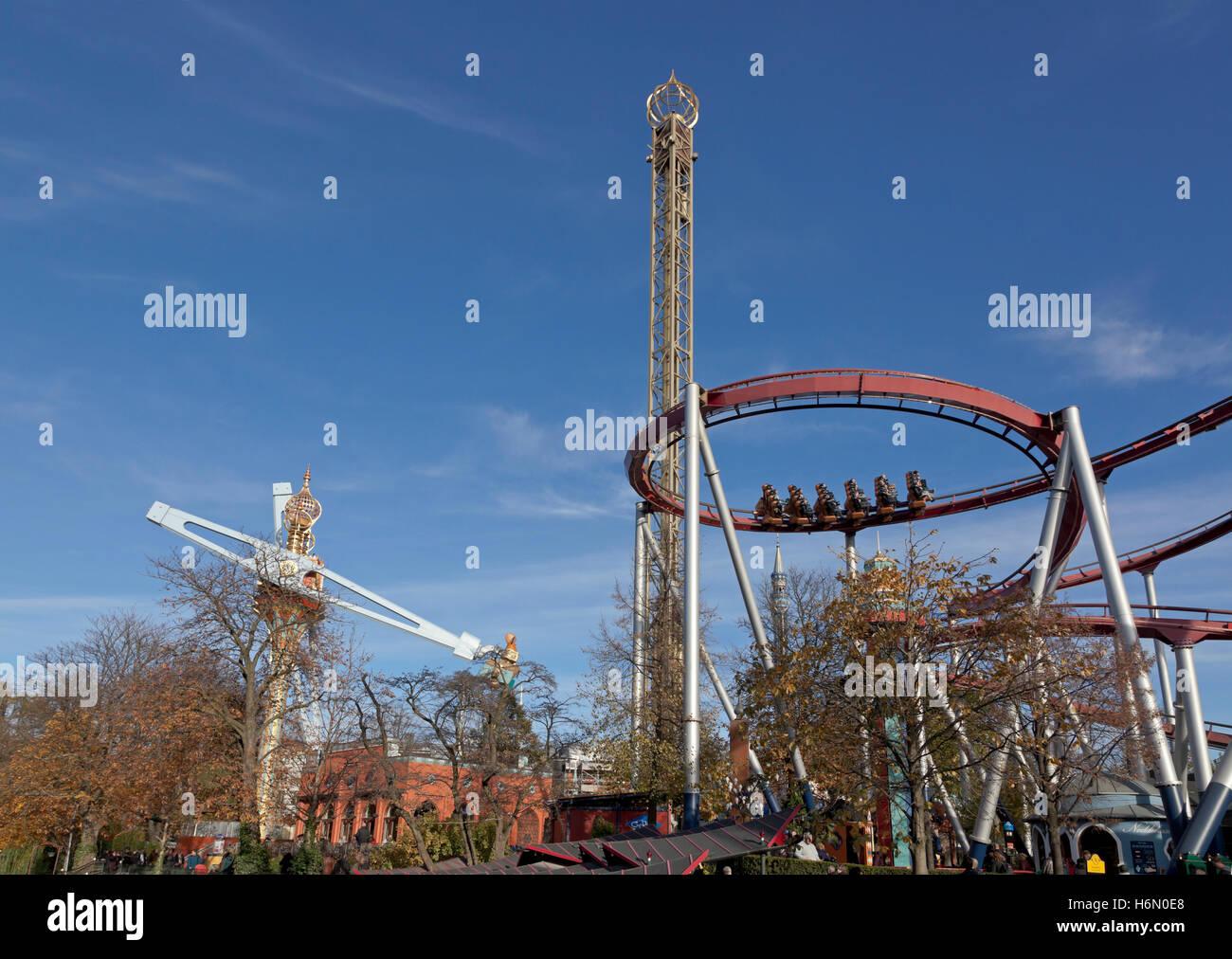 The Vertigo, the Golden Tower, and the Demon rides in Tivoli Gardens in Copenhagen on a sunny end October afternoon. - Stock Image