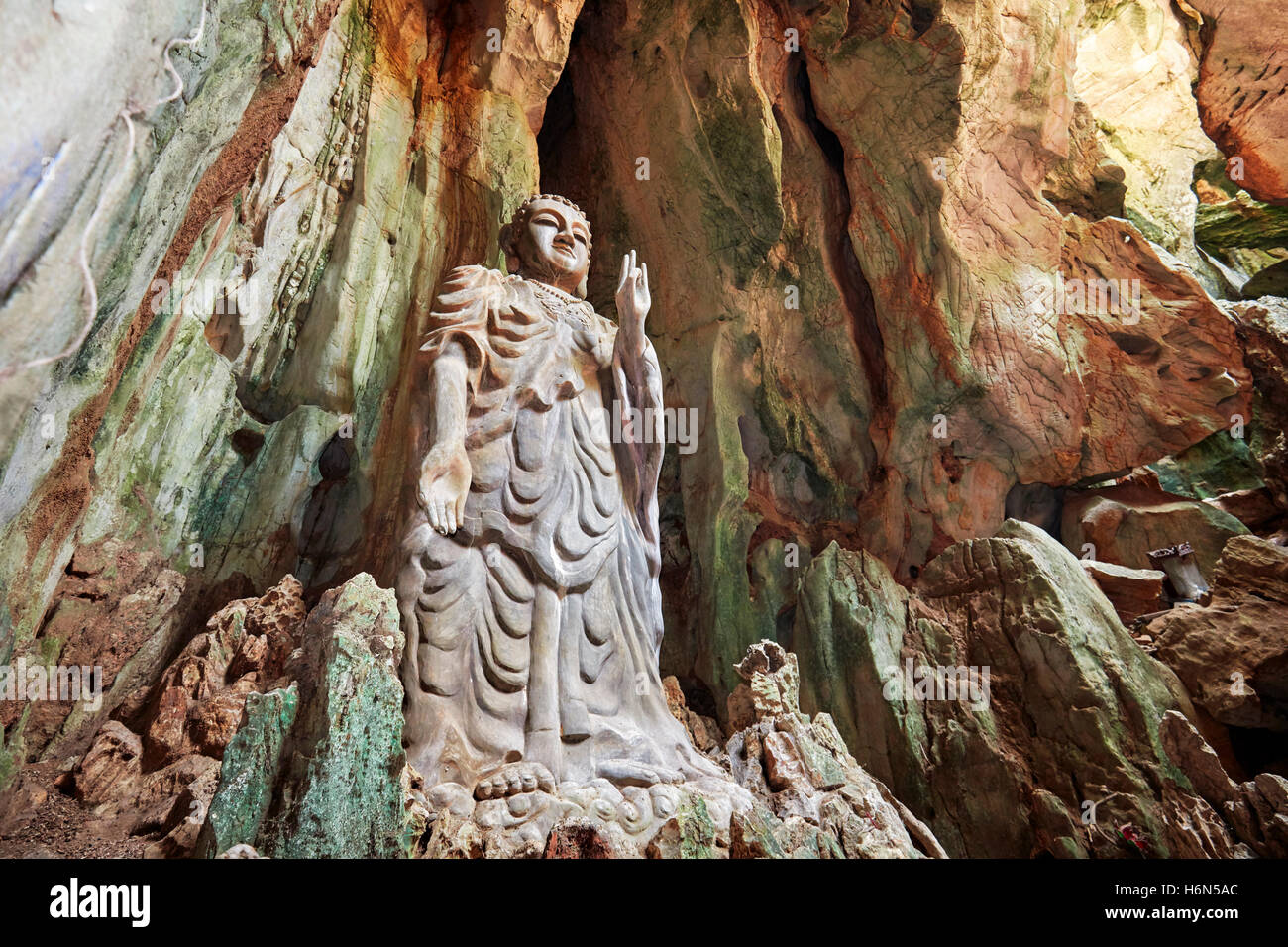 The Upright Buddha statue in Tang Chon Cave. Thuy Son Mountain, The Marble Mountains, Da Nang, Vietnam. - Stock Image