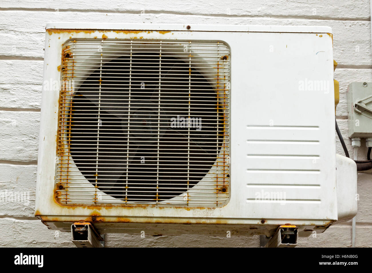 Old vintage rusting metal exterior fitted air conditioning