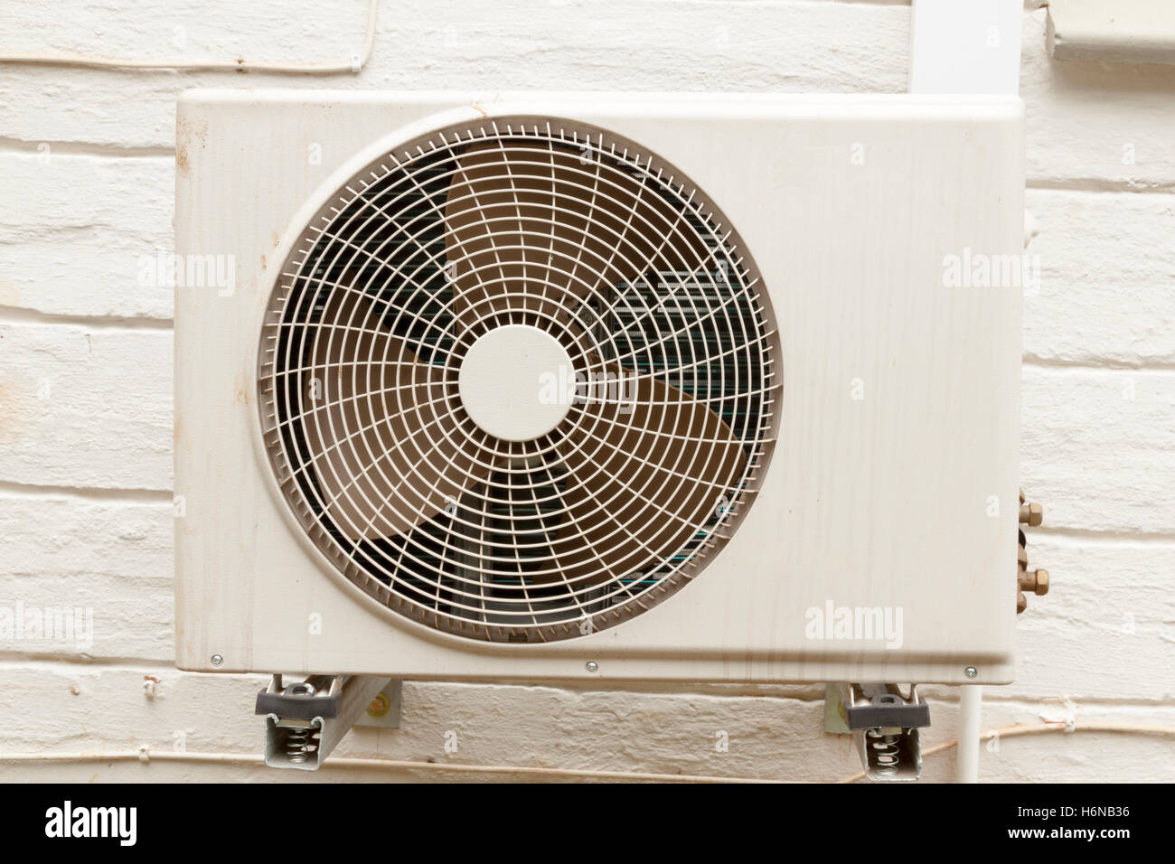 Single weathered white air conditioning unit mounted on