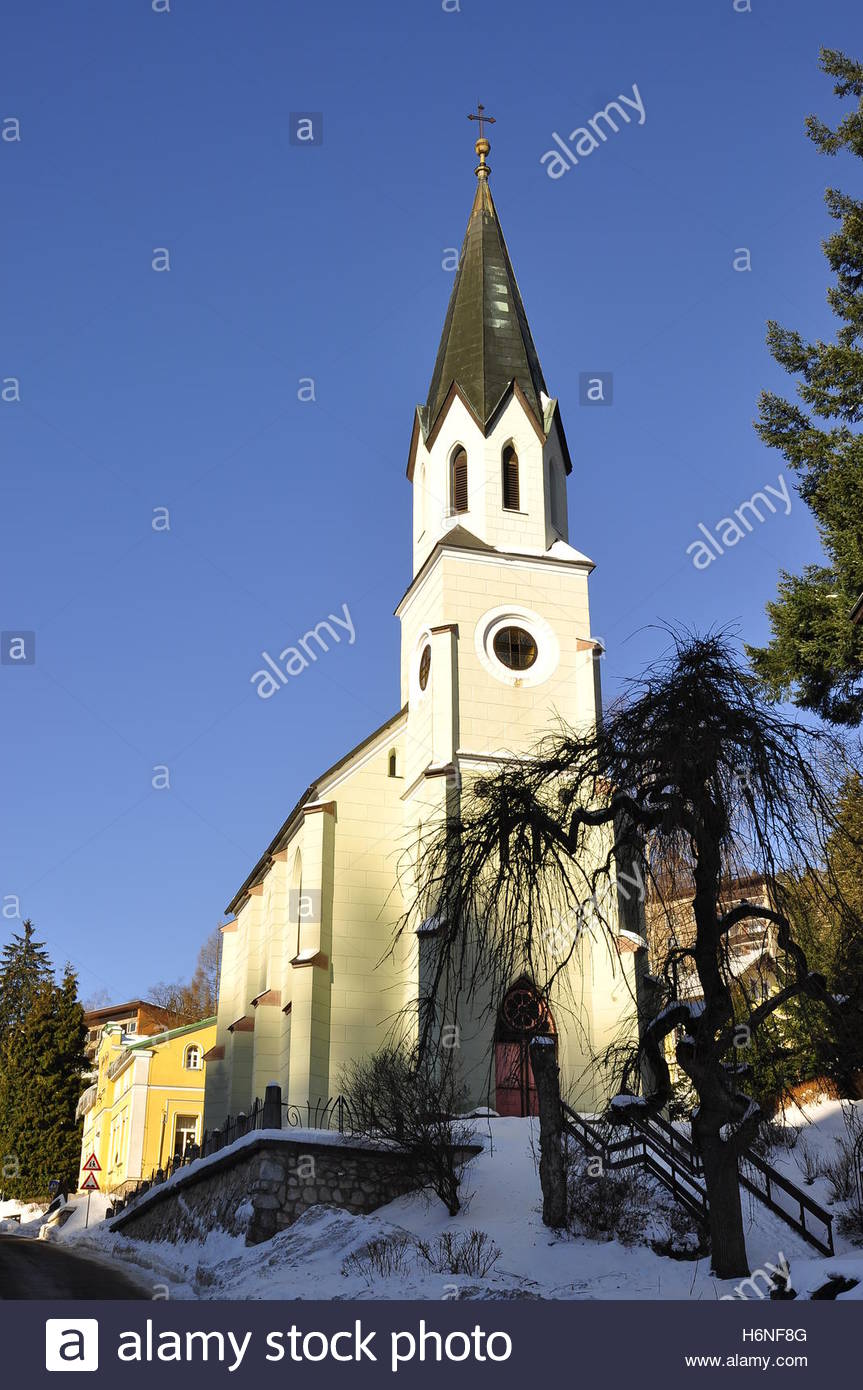 Evangelical Church of Czech Brethren, neo-Gothic church with polygonal tower. Janske Lazne, Czech Republic - Stock Image
