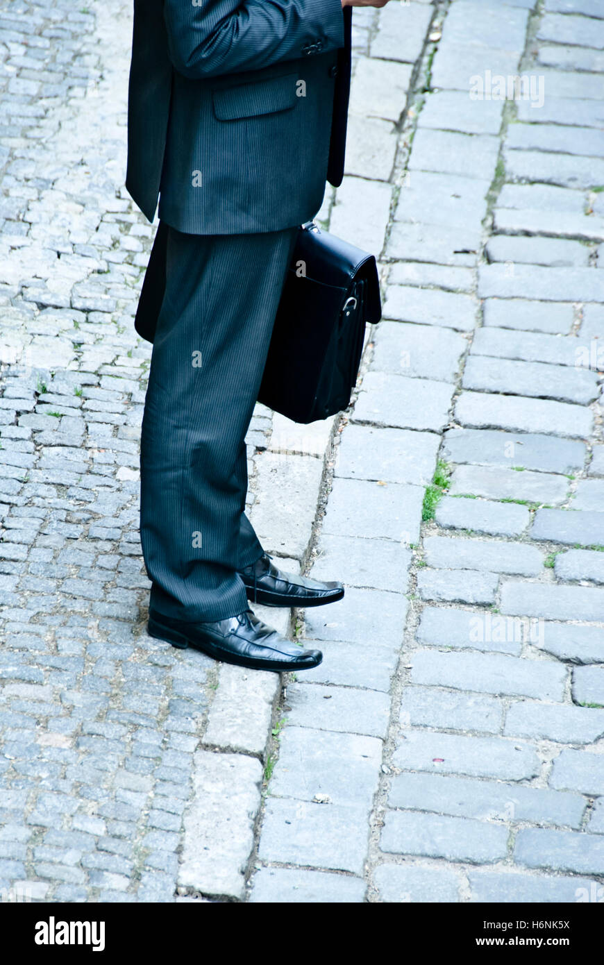 businessman with briefcase, legs only visible - Stock Image